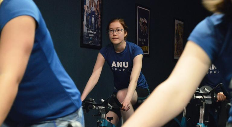 Girl riding stationary bike